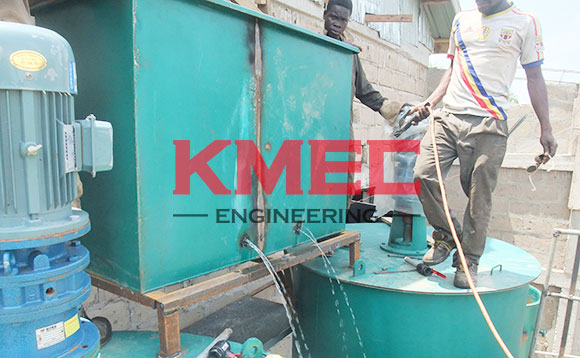 workers are   welding lye tank outlet valve